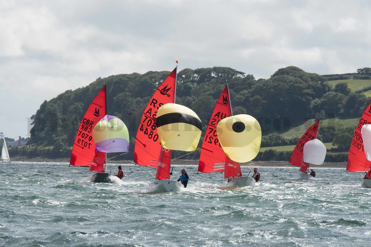 Mirror dinghies racing on a run with spinnakers flying